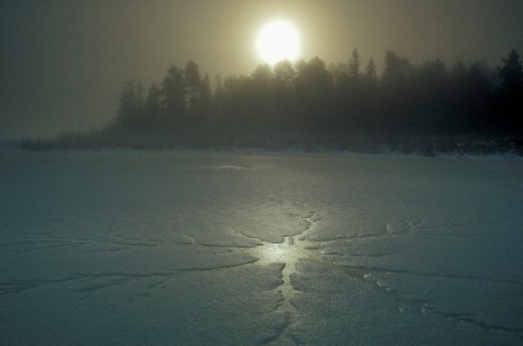 Milky sunrise over ice on beaver pond in early winter, Greater Sudbury, Ontario, Canada